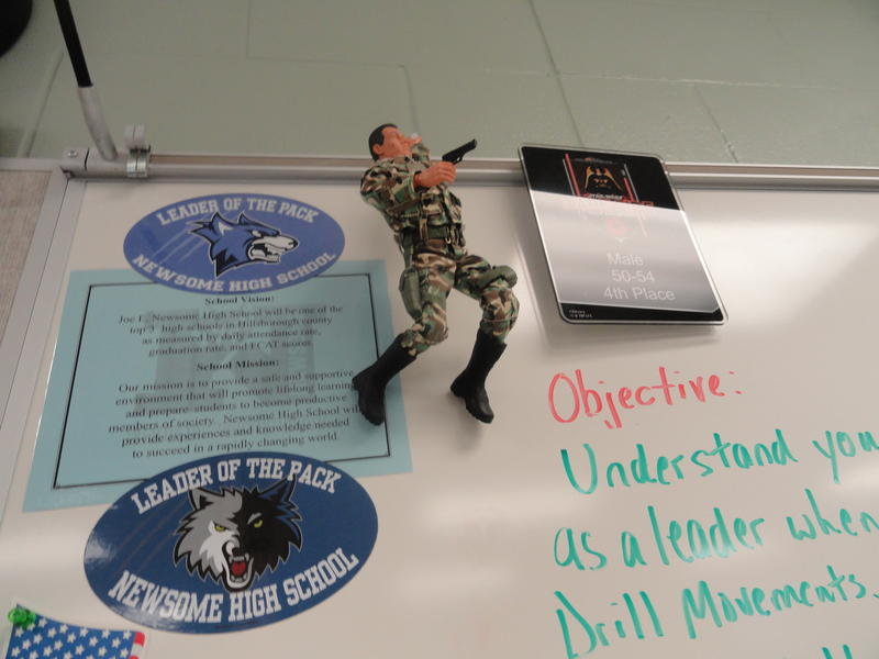 A GI Joe hangs from the whiteboard inside one of the JROTC classrooms at Newsome High.
