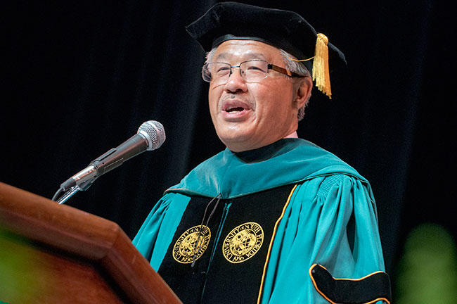 Dr. Victor J. Dzau, president of the National Academy of Medicine addresses the graduates and other attendees at the commencement.