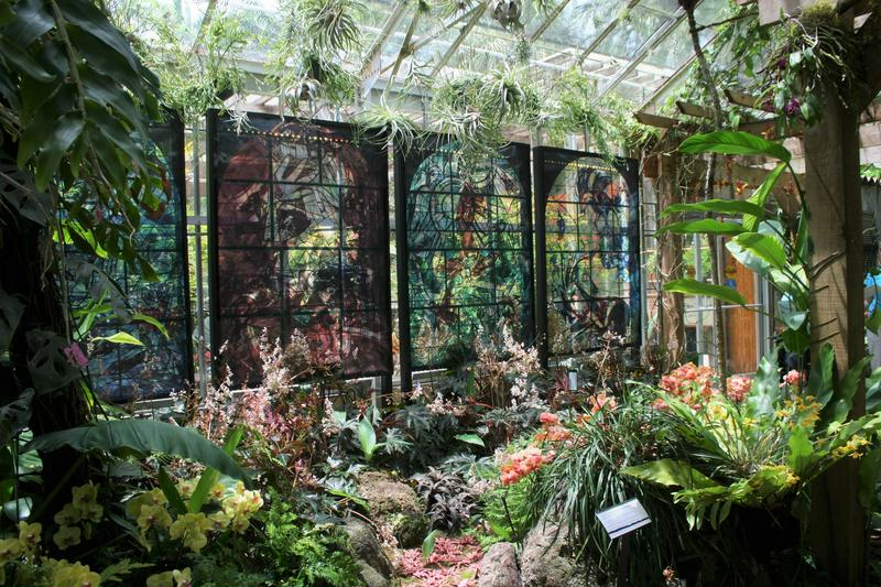In addition to several floral paintings on display, the exhibit features reproductions of stained glass artworks by Chagall in the conservatory.