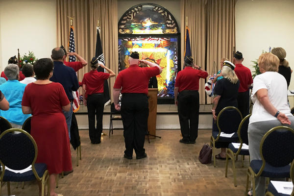 Veterans and family members at Tampa's American Legion Post 5 participate in a special Memorial Day ceremony for troops who died by suicide.