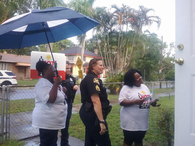 Community members and police canvassed recently in the Bartlett Park neighborhood of St. Petersburg  asking neighbors to help at- risk young men.