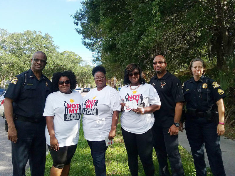 St. Petersburg Chief of Police Anthony Holloway, Nikki Hall, Sherry Roberts, Roslynn Tarver, St. Petersburg Community Intervention Director, Kenny Irby, and Sgt. Patricia Houston gathered before a canvas effort in St. Petersburg.