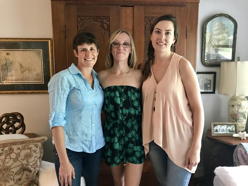 Foster parents Elizabeth and Kate Dumbaugh stand on either side of their friend Katherine Mullins, whose son Aiden was recently in the Dumbaughs' care while she recovered from her heroin addiction.