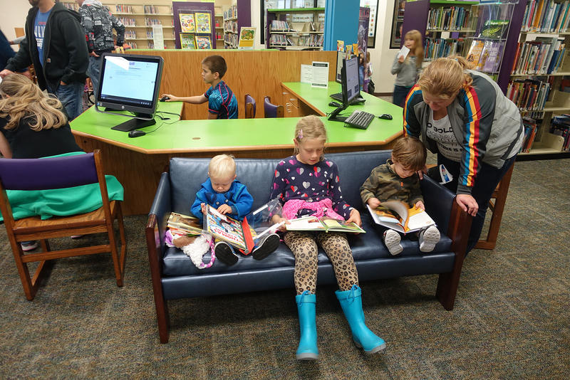 Kids reading inside Manatee County Public Library.