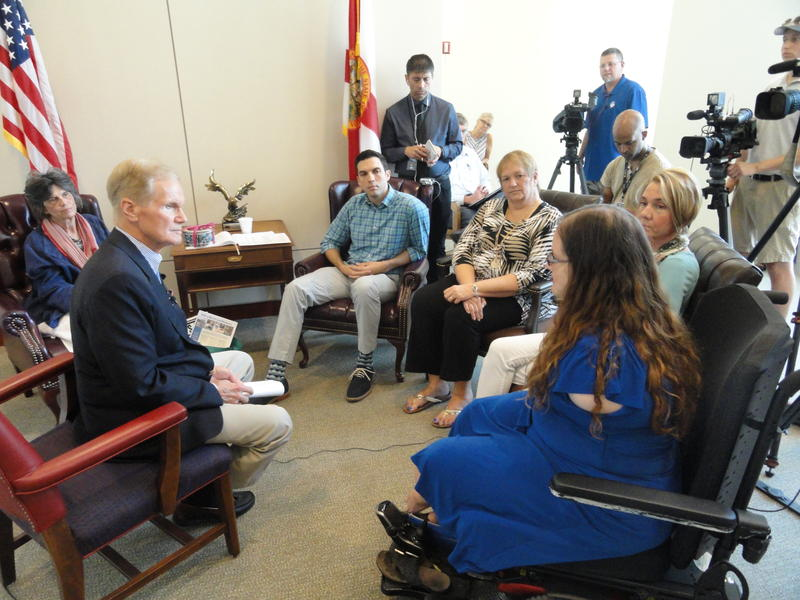 Sen. Nelson hears stories from Medicaid enrollees at the Sam Gibbons Federal Courthouse in Tampa Monday.