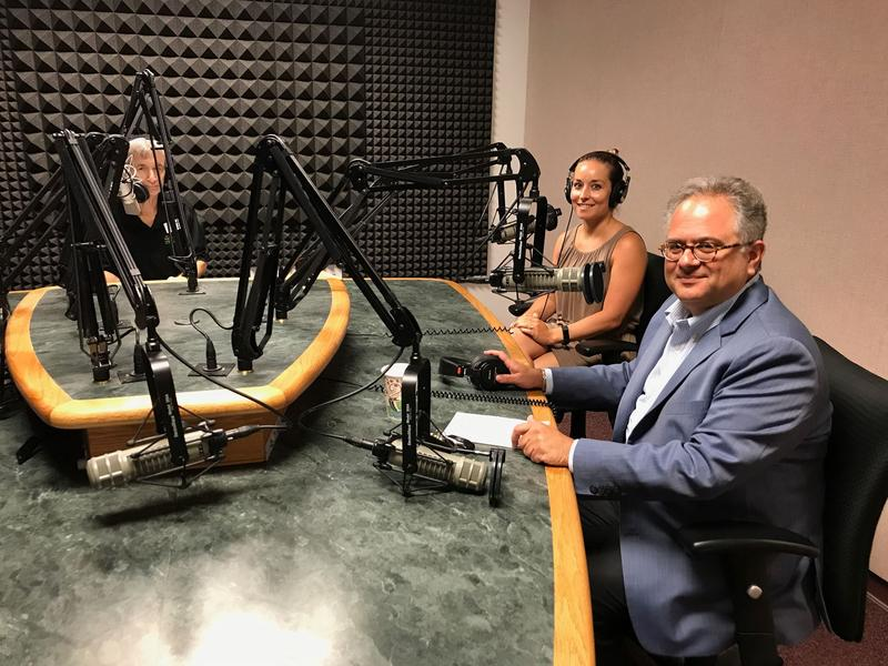 Florida Matters host Carson Cooper (l) talks sea level rise with research scientist Davina Passeri, Tampa Council Member Harry Cohen and South Florida environmental lawyer Stephen Tilbrook (not pictured).