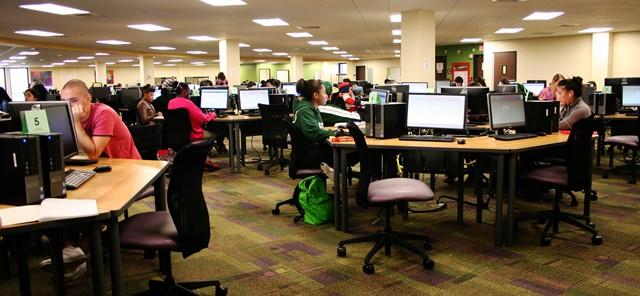 Students studying in the SMART Lab at USF Tampa Library.
