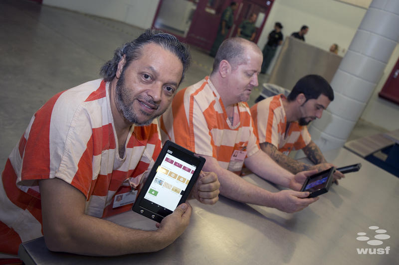 Miguel Perez, Doney Bedford, and Christopher Murgatroyd - all inmates at the Land O' Lakes Detention Center show off the tablets the jail received last week.