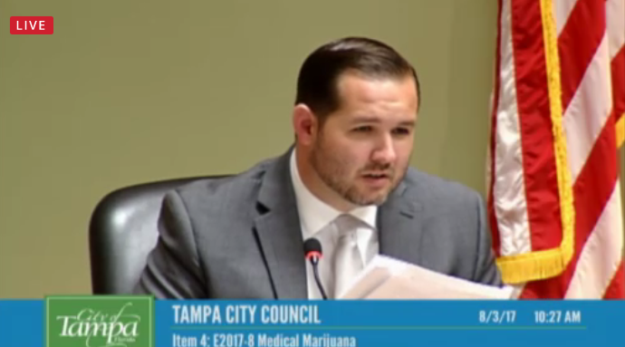 Tampa City Councilman Guido Maniscalco reads the proposed medical marijuana ordinance.