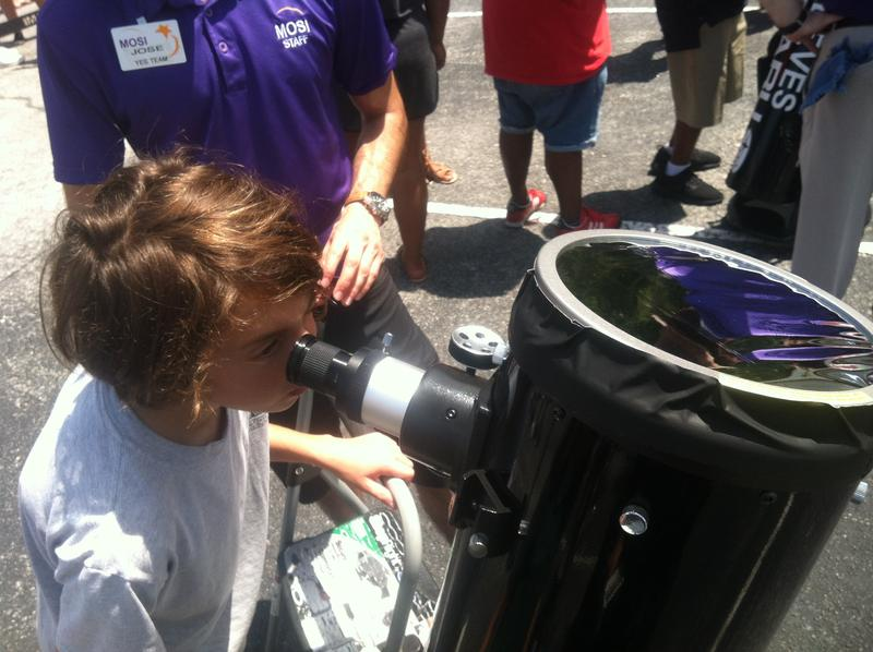 Zane Newborn, 11, looks through a specially-equiped telescope
