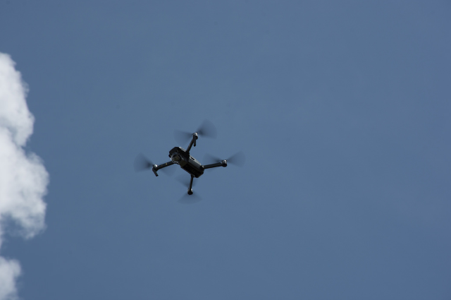 A USF drone flies over the scene.