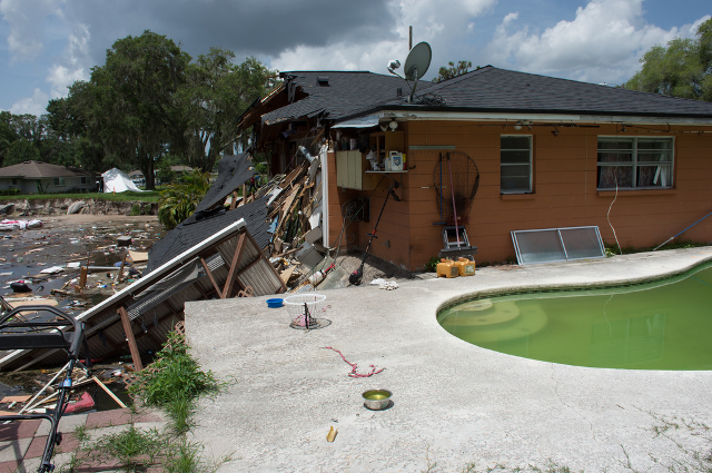 Original progression of the Pasco County sinkhole on July 14 came to a stop at the edge of the patio of the second house, but not before half of the structure collapsed.