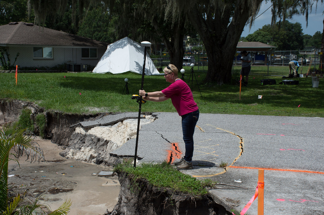 Dr. Lori Collins studies last month's sinkhole in Pasco County.