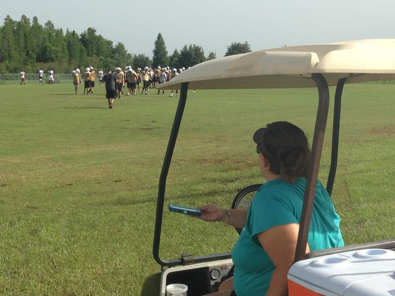 Sunlake High athletic trainer Tara Mendres watches football practice.