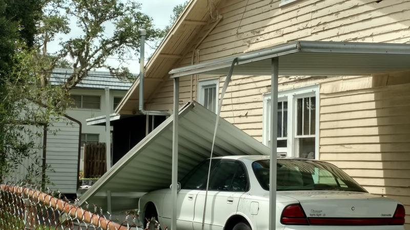 A carport landed on a car during Irma.