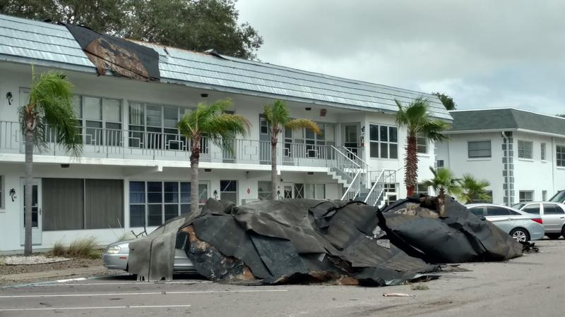 At least 4 cars & multiple apartments damaged when roof of Drew Ridge Apts. in Clearwater blew off.