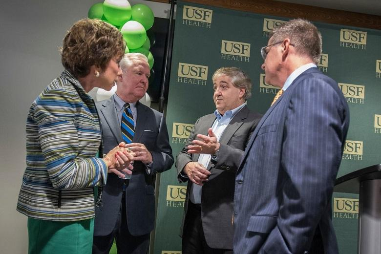 "USF System President Judy Genshaft (left) speaks to Tampa Mayor Bob Buckhorn and Tampa Bay Lightning owner Jeff Vinik at a Wednesday event marking the beginning of construction of the USF Morsani Medical School in Vinik's ""Water Street"" project."