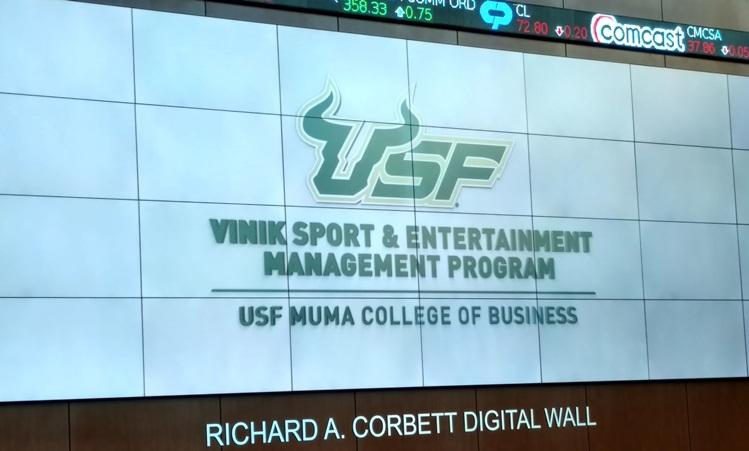 The new name of the USF Vinik Sport and Entertainiment Management Program on the USF Muma College of Business video wall.