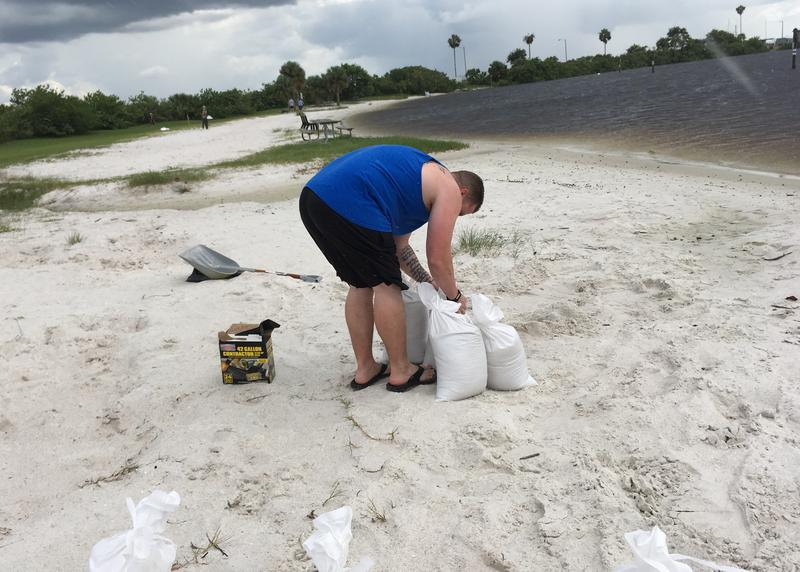 Another resident filling sandbags at Davis Islands Beach ahead of Hurricane Irma and expected flooding.