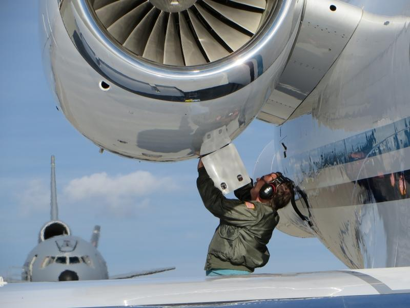 A maintainer services an engine on NOAA's Gulfstream IV-SP jet.