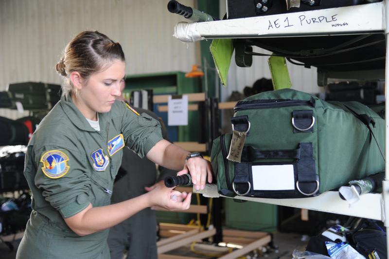 Senior Airman Patrice Barnett, 45th Aeromedical Evacuation Squadron, medical technician, prepares medical transport equipment in preparation of evacuating victims of Hurricane Maria.