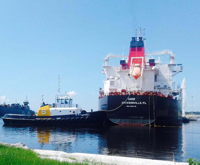 A tug manuevers the tanker Ohio into position to unload fuel at Port Tampa Bay.