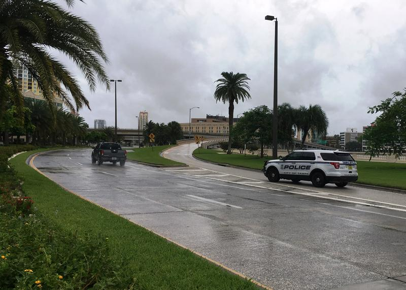 A Tampa Police vehicle blocks the Bayshore ramp to Davis Islands, a Level A area under mandatory evacuation.
