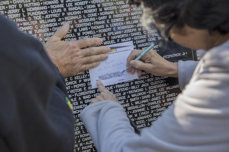 Linda Bessie makes an etching of her late sister's fiance's name, John D. Andrade, who died at 20 in the Vietnam War.