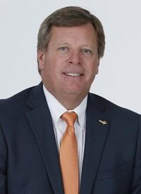 The Univ. of Floridalet football coach Jim McElwain go  nearly a week after he said his players and their families had received death threats.