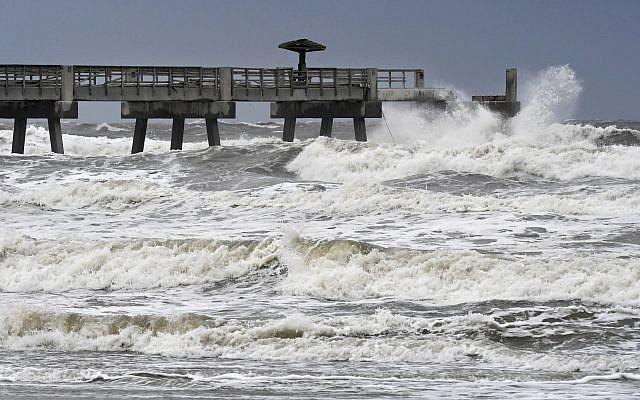 Waves crash on the Jacksonville Beach Fishing Pier in Jacksonville Beach, Florida, as Hurricane Irma approaches
