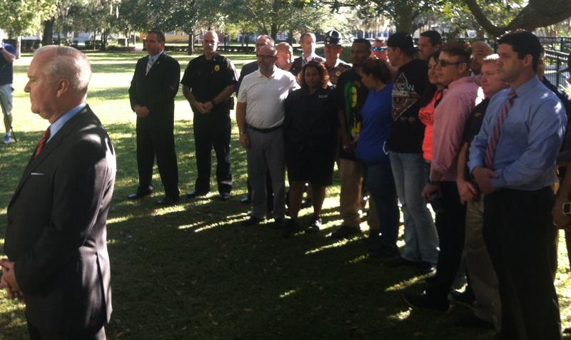 Family members of the victims gather alongside Tampa Mayor Bob Buckhorn
