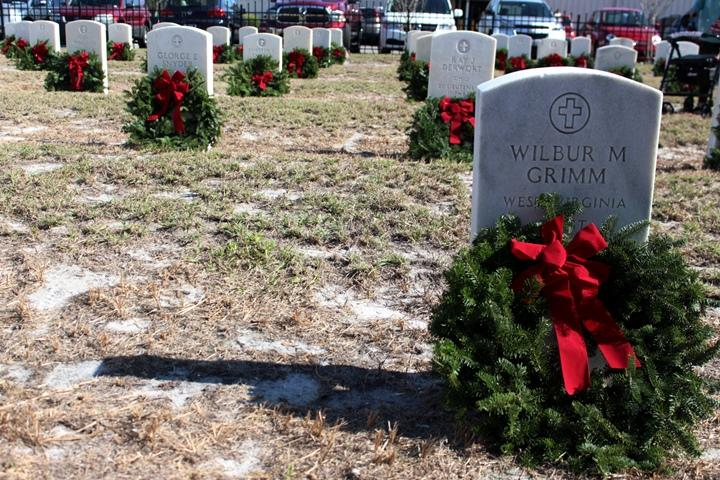 The Wreaths Across America event in Tampa was held simultaneously with an event at Arlington National Cemetery where wreaths were laid on the graves of more than 400,000 veterans.