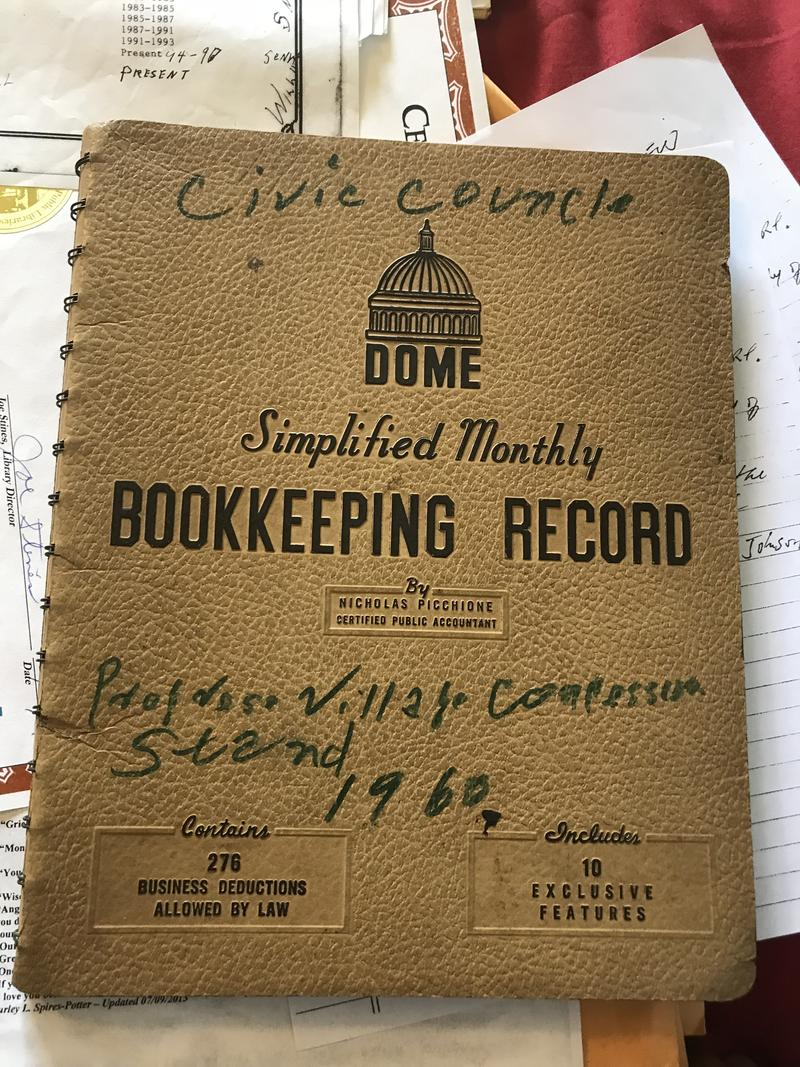 "Emmanuel P. Johnson's bookkeeping record for the concession stand, where he sold things like RC Colas and a Progress Village favorite ""frozen cups,"" which were made of flavored syrup and water."