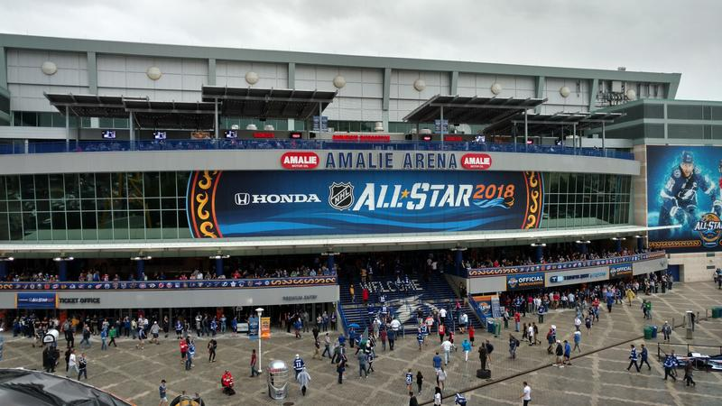 Fans dodged the rain outside the Amalie Arena in Tampa before the NHL All-Star Game Sunday.