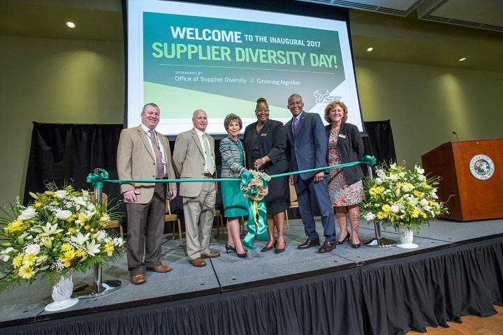 USF officials, including System President Judy Genshaft (center), cut a ceremonial ribbon at Supplier Diversity Day in Oct. 2017.