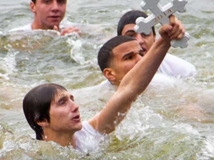 More than 50 boys in T-shirts and shorts will plunge into Spring Bayou on Saturday, competing to be the first to find a wooden cross.