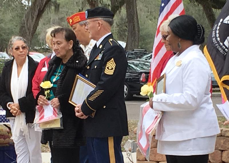 During the Field of Honor ceremony, Gold Star mothers Barbara Wade, right, and Nitaya Rubado, left, in between Charles Rubado, a Gold Star father.