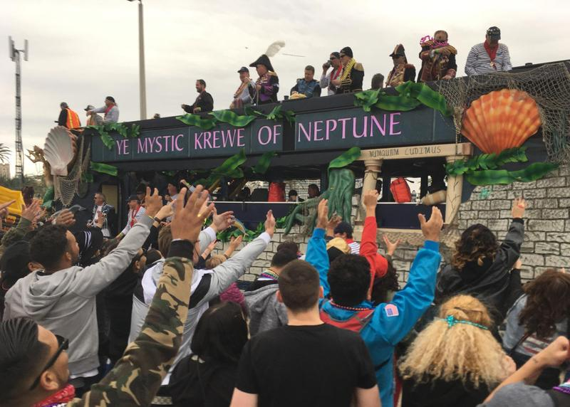 "People cheering for colorful beads as floats go by during the 2017 Gasparilla Parade of Pirates. The parade always follows ""The Invasion"" of the Jose Gasparilla pirate ship. This year the Stanley Cup will be on the ship."