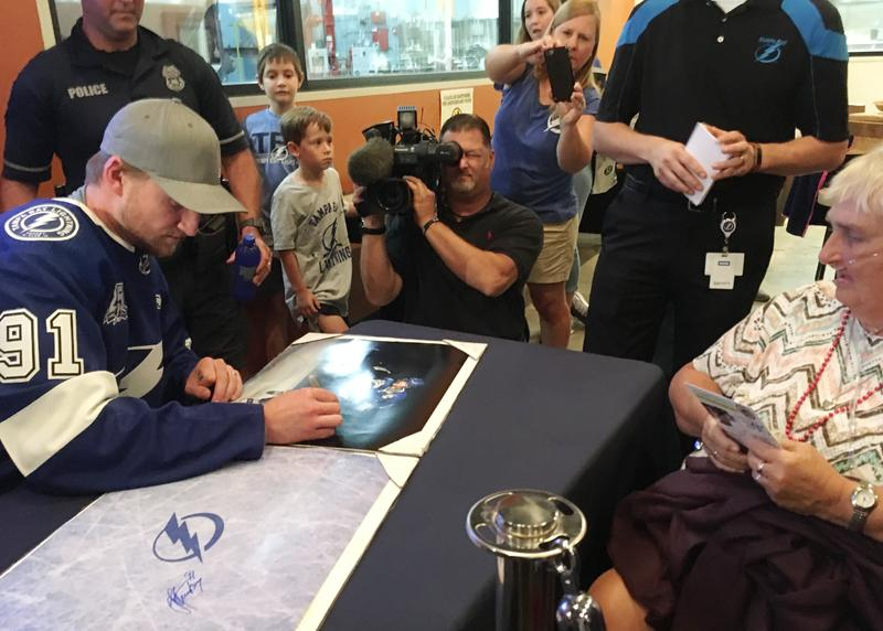 Lightning captain Steven Stamkos signing autographs at a Seminole Heights brewery to help bring people back into the neighborhood that had been plagued by a random killer.