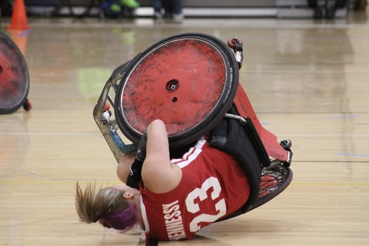 Players of wheelchair rugby are often knocked over when they suffer a major hit on the court.