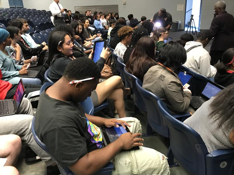 Students at King High School gather in the auditorium to register and preregister to vote, based on their age.