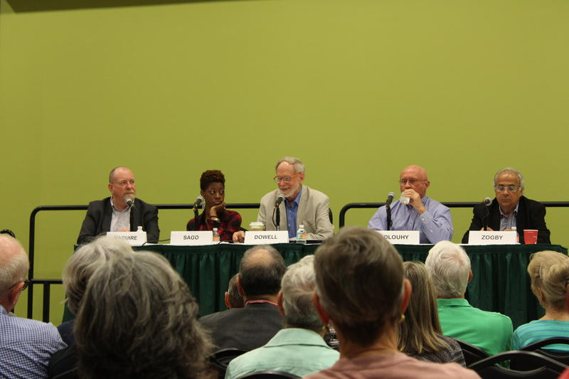 Panelists at the St. Petersburg Conference of World Affairs on Friday. Panalists are (from left) John Maguire,  Renata Sago, Bill Dowell, David Dlouhy and John Zogby.