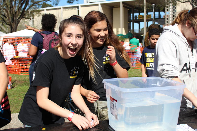 Tiffany Heid (left), 13, and Mia Gontowski, 13, from Mann Middle School at the USF Engineering Expo on Friday. The two-day event, full of hands-on experiments, is a way to connect students with science subjects.