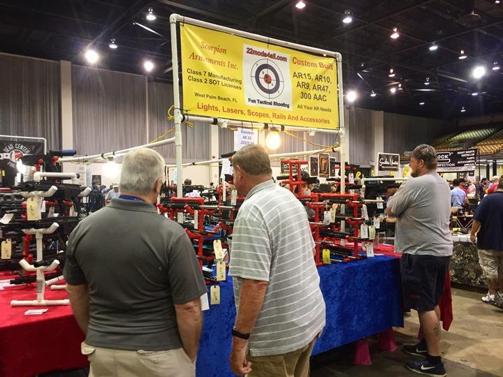 On the show floor over the weekend, signs advertised AR-15's and high capacity magazines for sale.
