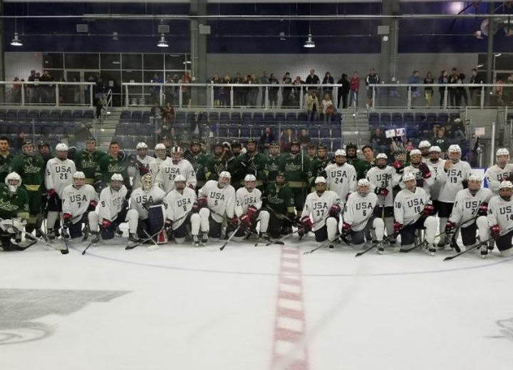 Members of the U.S. women's national hockey team and the USF Ice Bulls pose after facing off in Wesley Chapel in Oct. 2017. The U.S. women won both games against the USF men, 8-1 and 6-1.