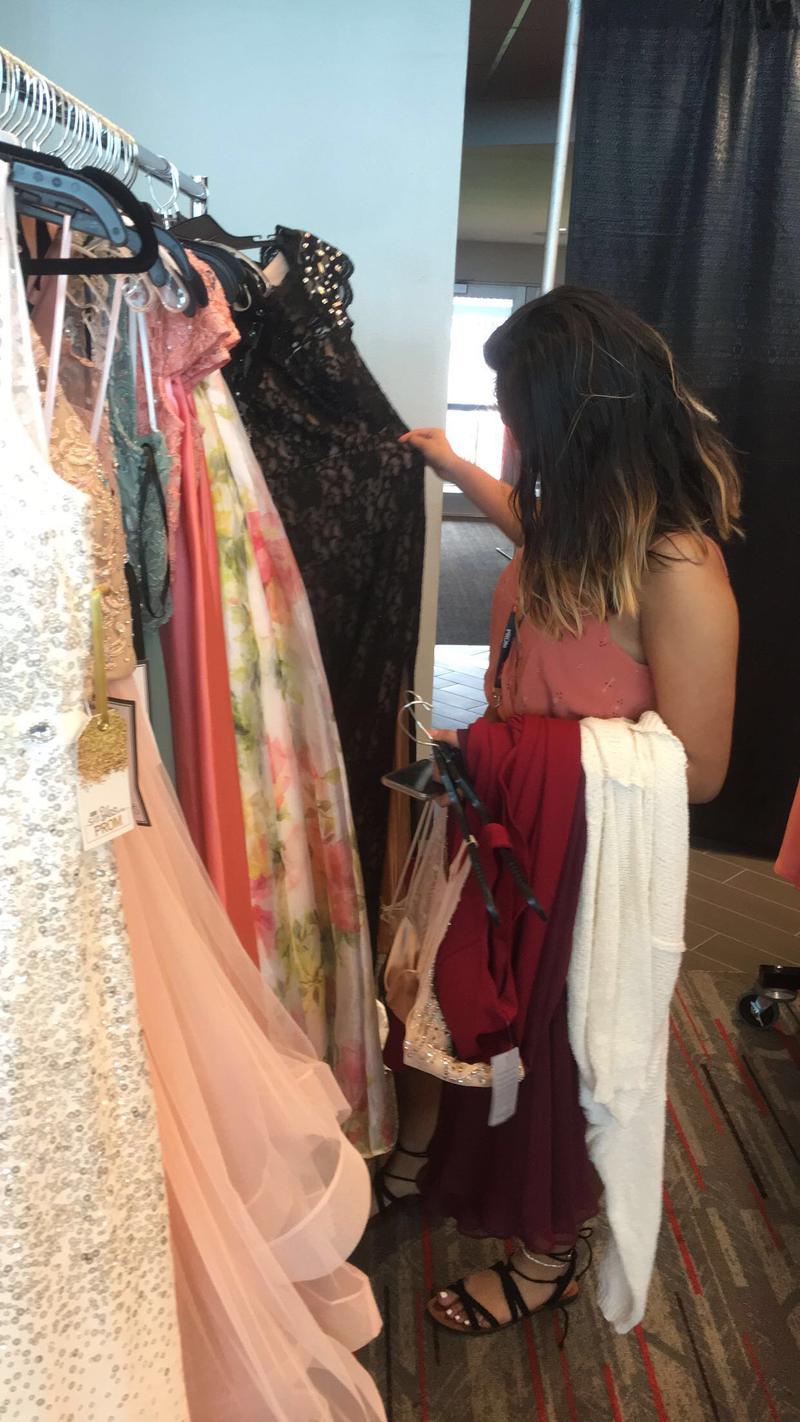 Spoto high school senior Juliana Jaimes picking out prom dresses