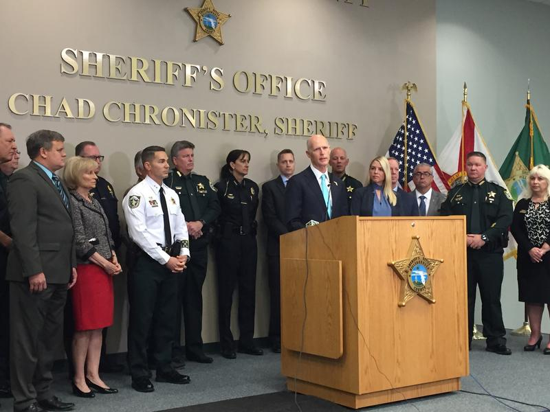 Gov. Scott addresses his new plan to improve school safety and gun laws at an event at Hillsborough County Sheriff's Office on Wednesday.
