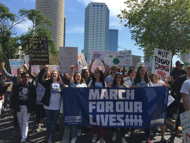 The main organizers of the Tampa March for Our Lives lead the crowd in a march around downtown Tampa.