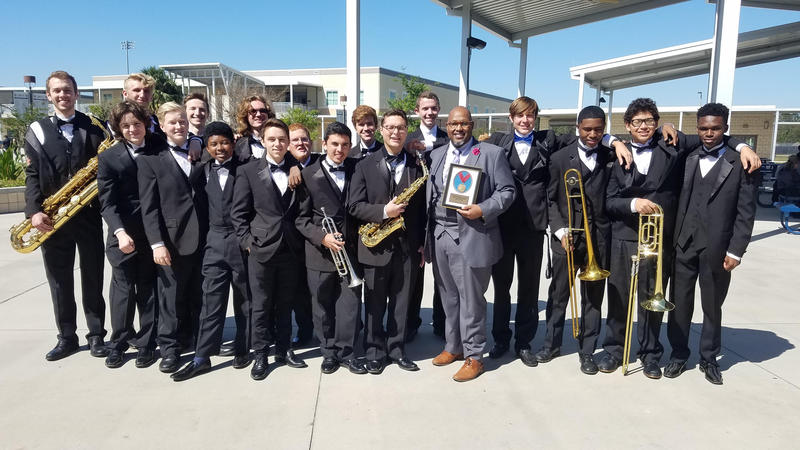Band director Michael Kernodle with members of the Lakewood High School jazz ensemble. On April 8, the band will perform at the New York City Jazz Festival at the Apollo Theater.