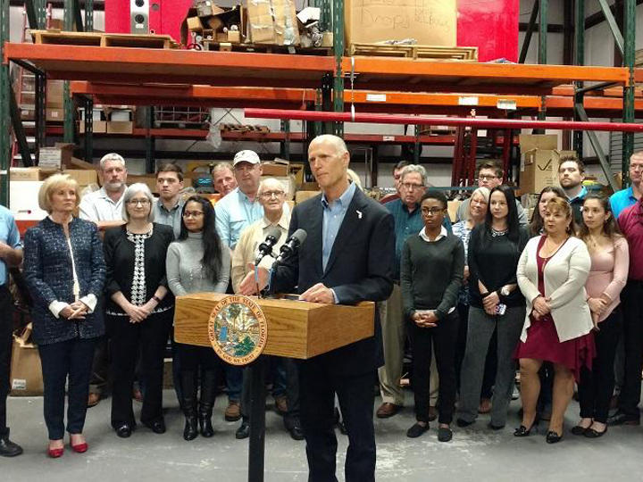 Gov. Rick Scott speaks about the tax cuts in the 2018-19 Florida budget at Cox Fire Protection in Tampa on Mar. 14. Scott vetoed $64 million from the budget Friday.